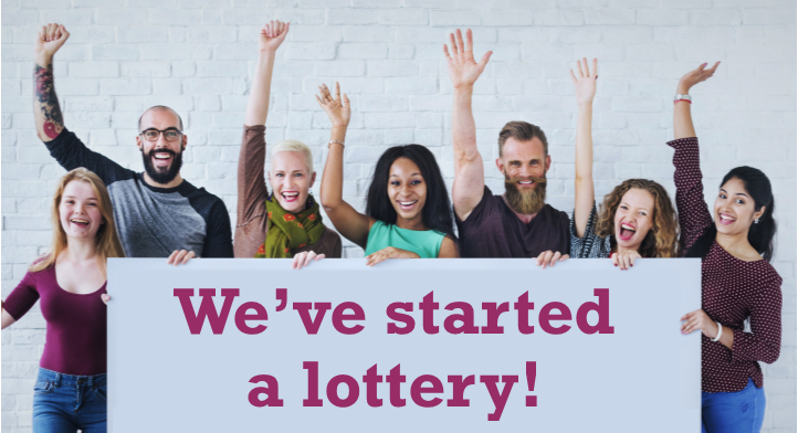 People celebrating starting their fundraising lottery